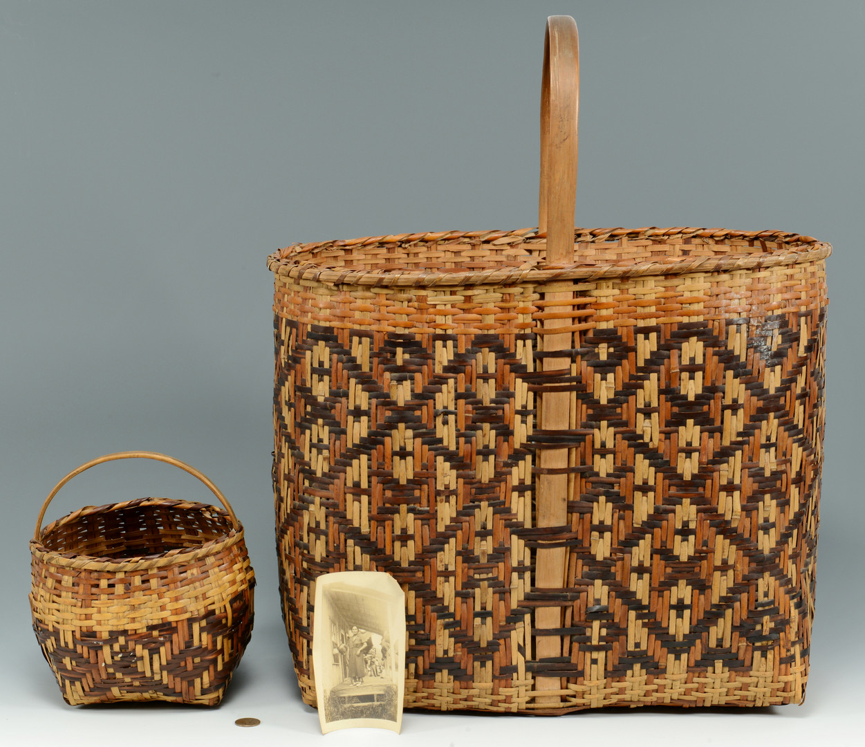 Lot 338: Early Cherokee River Cane baskets, 1937 photo