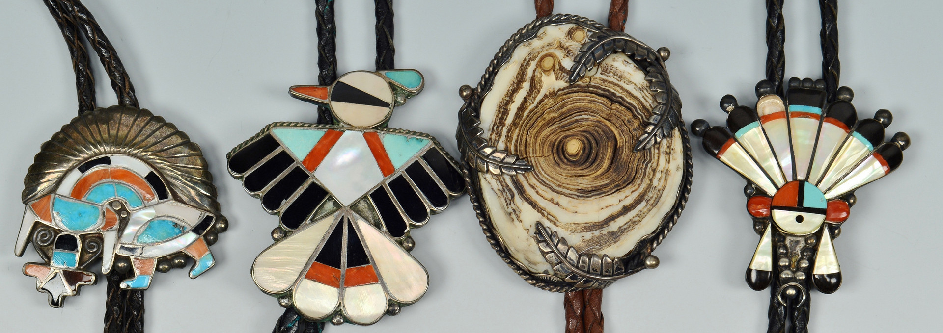 Lot 345: 7 Navajo / Zuni Bolos and 1 Buckle