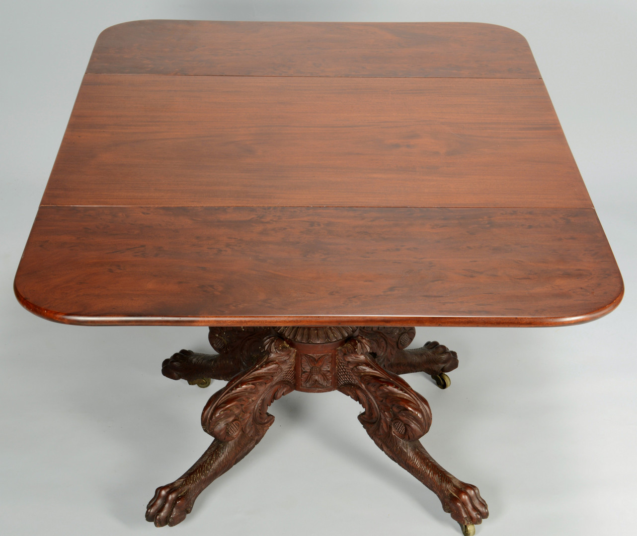 Lot 385: Classical Breakfast Table, Paw Feet