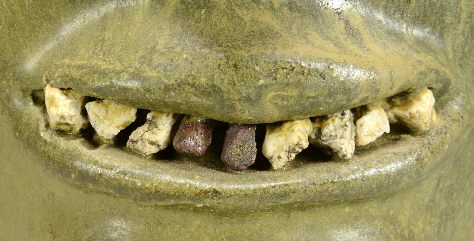 Lot 393: Lanier Meaders Face Jug, rock teeth