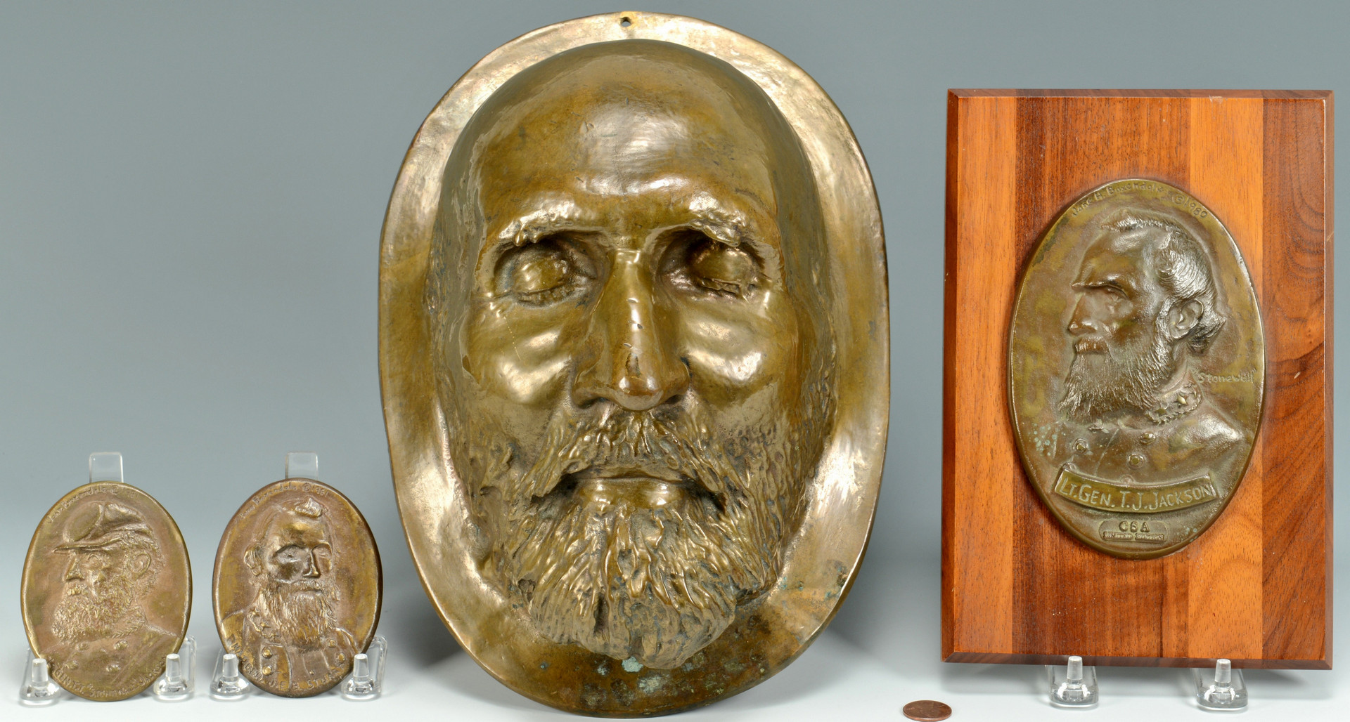 Lot 433: Bronze Death Mask and 3 CSA medallions