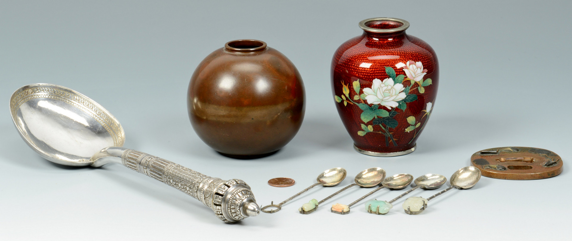 Lot 482: Grouping of 9 metal Asian items