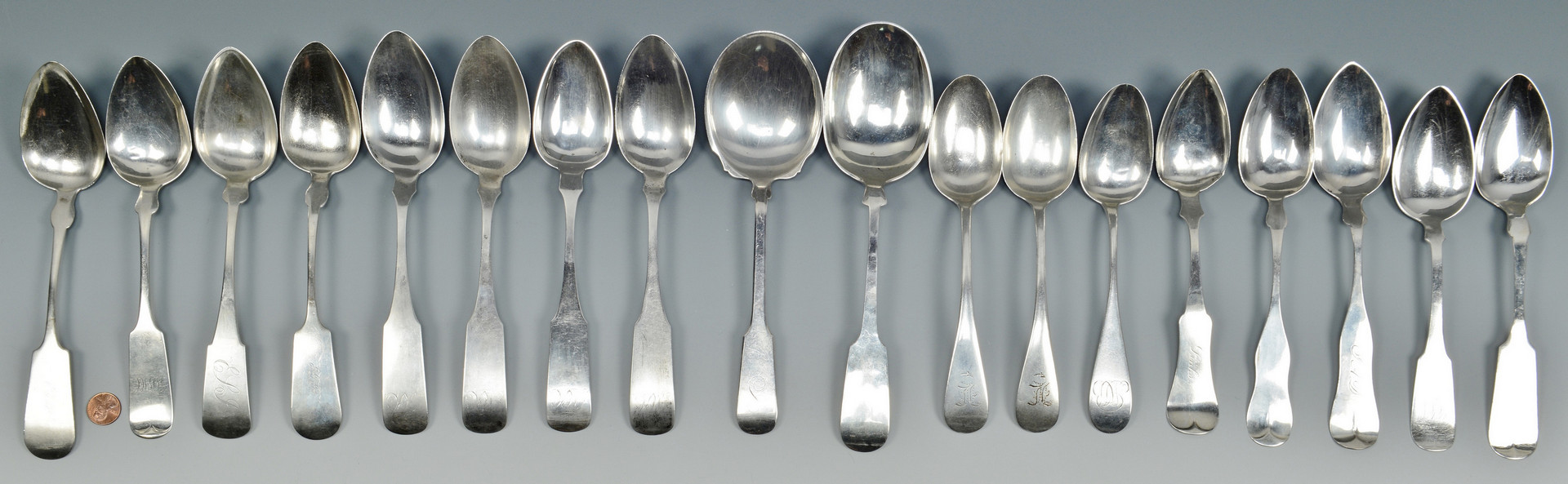 Lot 510: 18 Silver Table and Serving Spoons