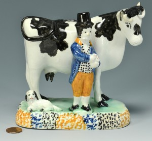 Lot 557: Pearlware figure: Farmer and Cow