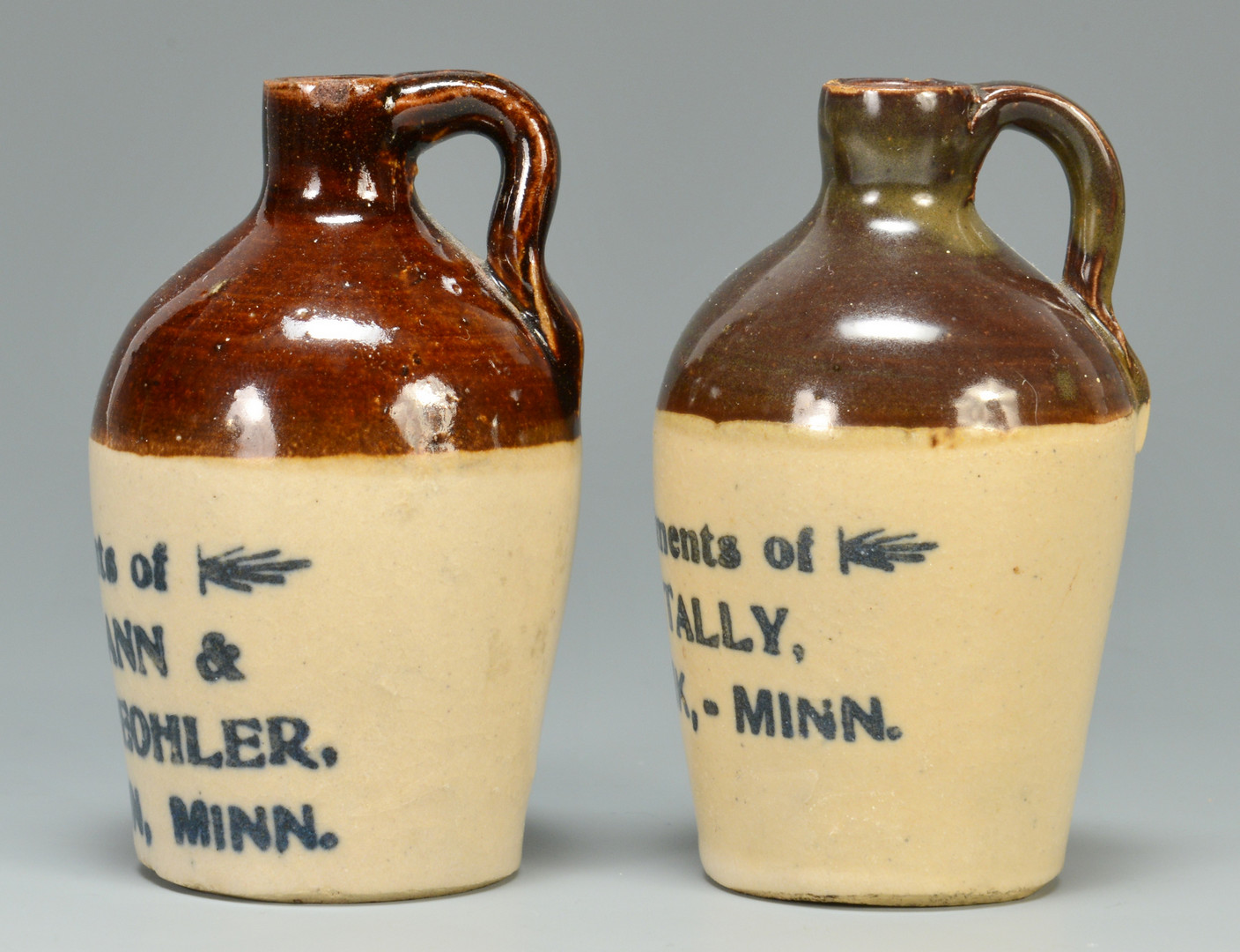Lot 597: 2 MN Miniature Whiskey Jugs