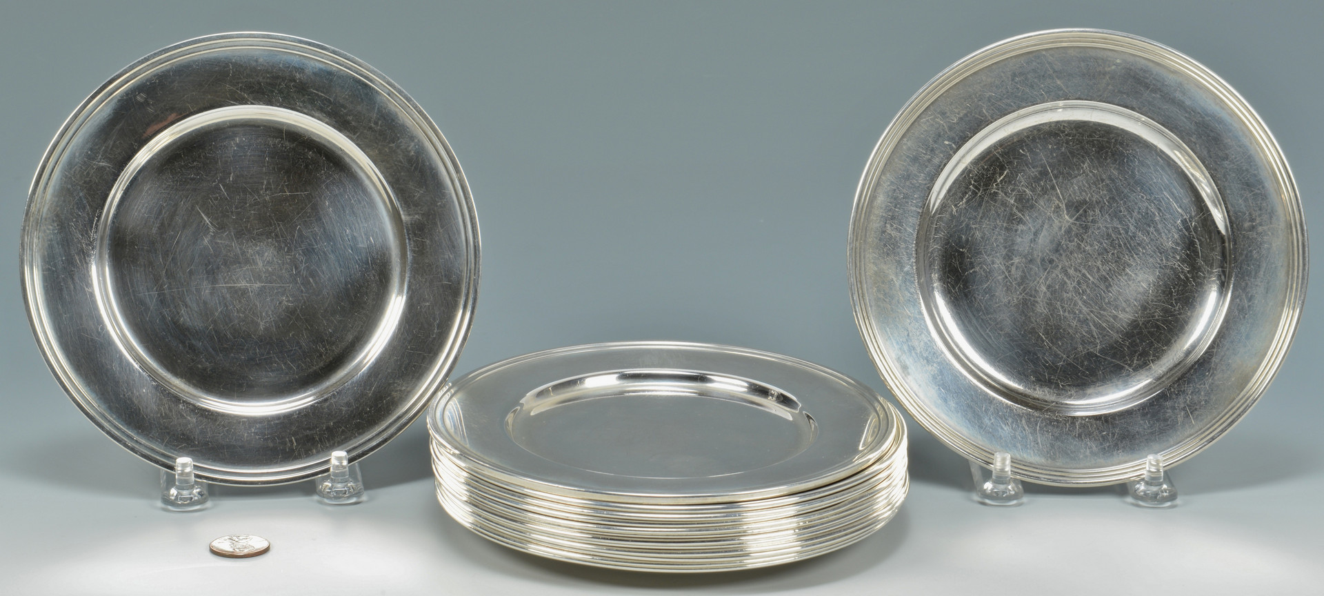 Lot 689: 14 Sterling Silver Bread Plates