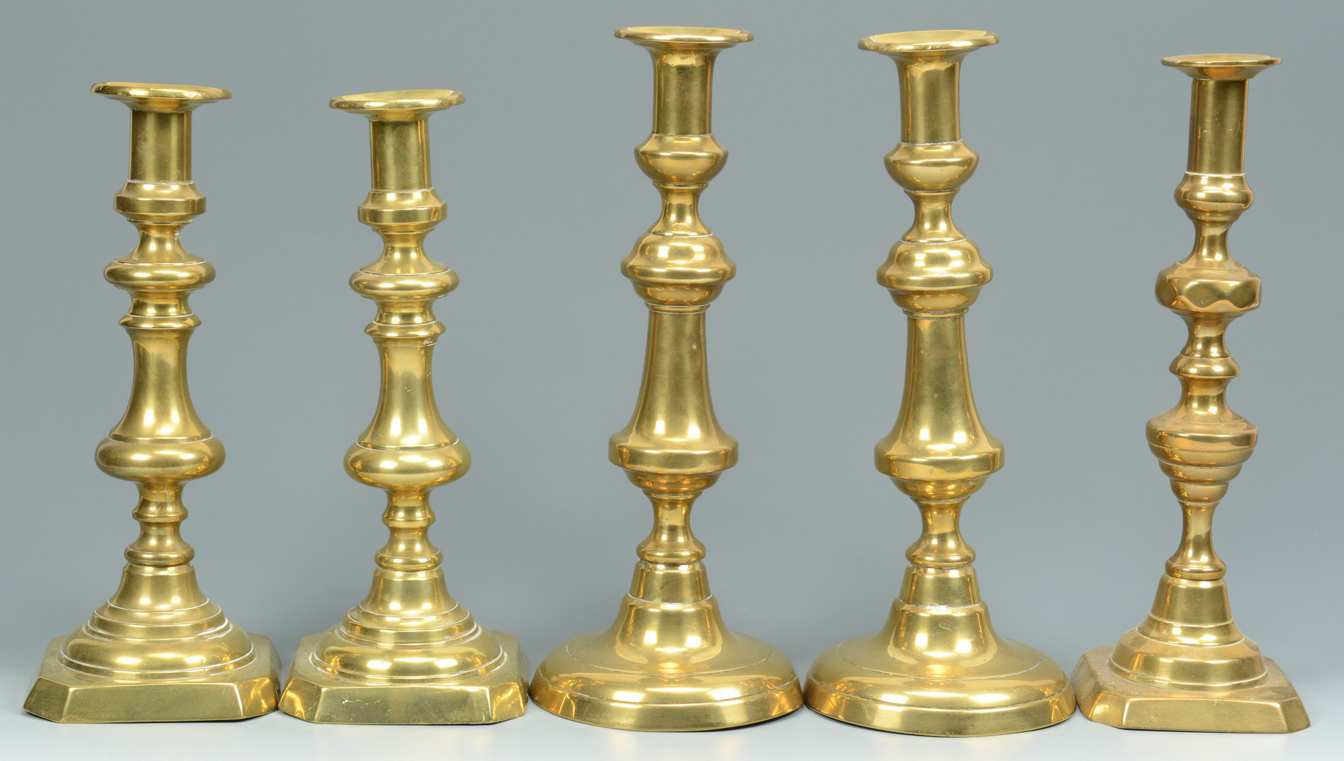 Lot 705: Grouping of Brass Candlesticks, 15 total