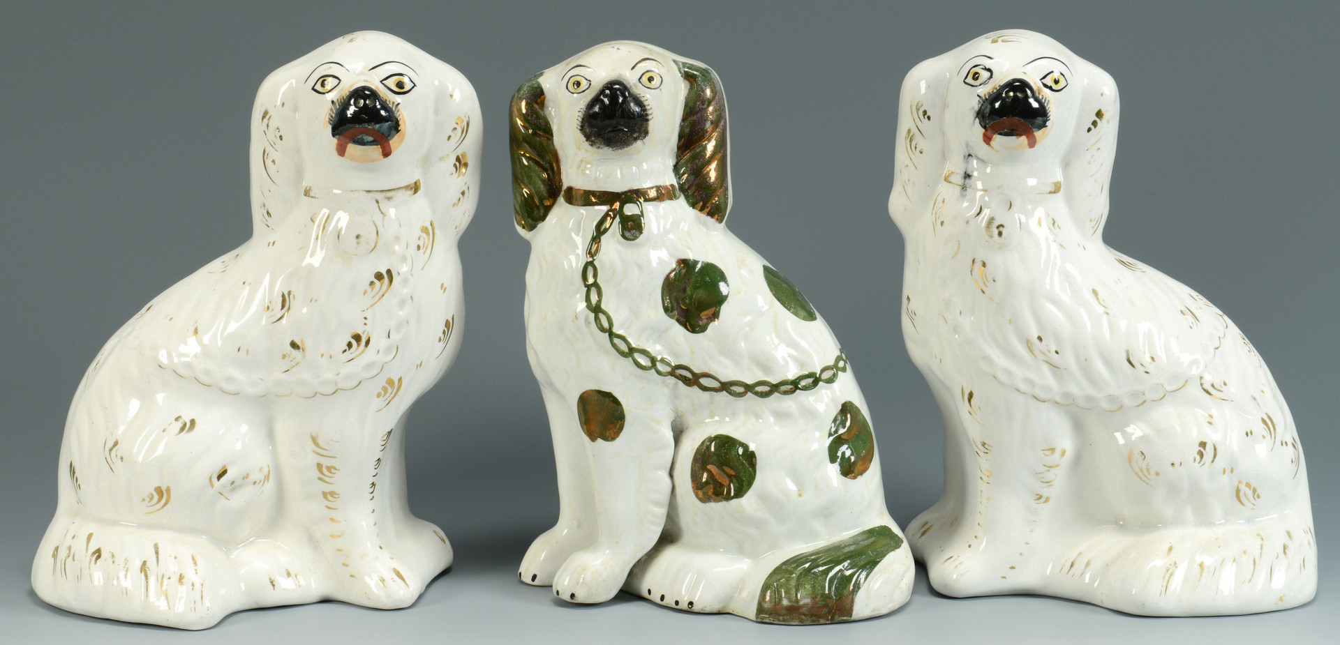 Lot 757: 3 Staffordshire Dogs and 1 Watch Holder