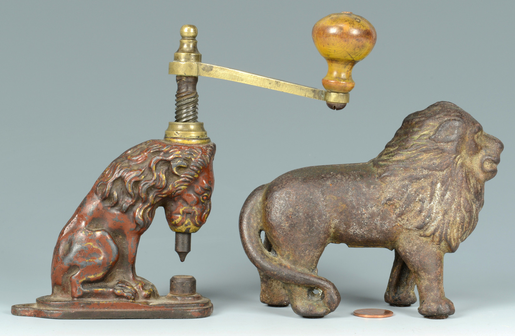 Lot 843: Cast Iron Lion Hole Punch and Bank