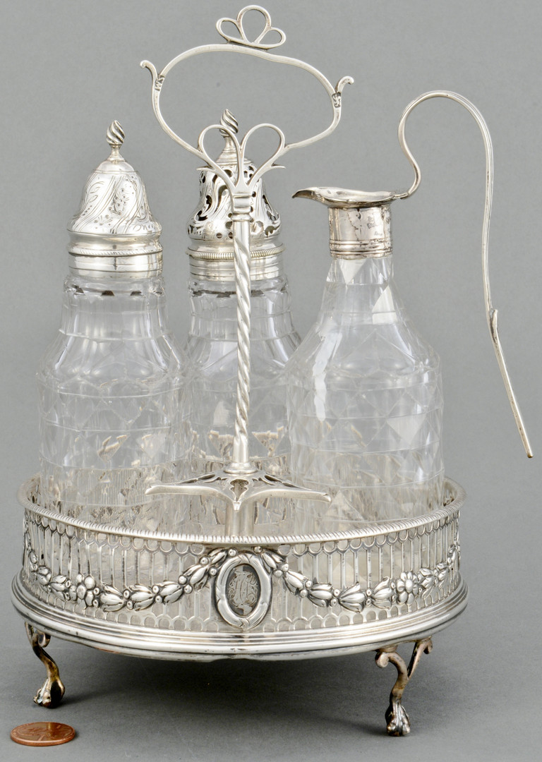 Lot 87: George III Sterling Cruet Frame and Bottles