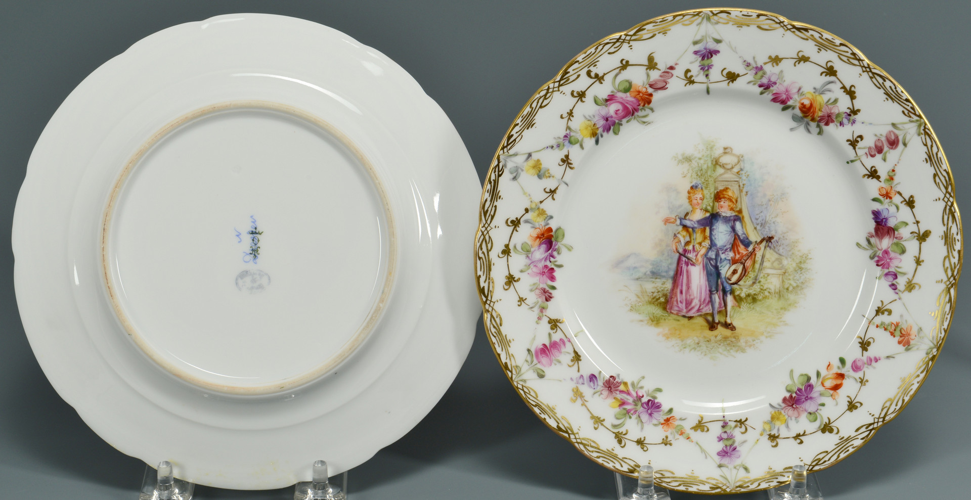 Lot 890: Pair European style Figurines & Plates
