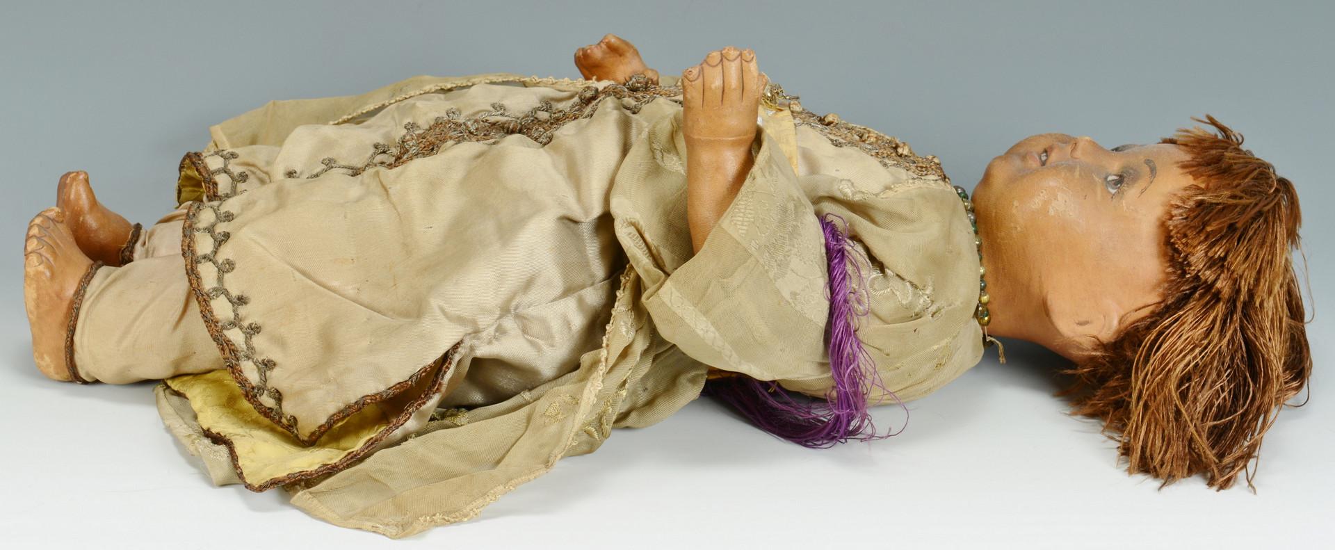 Lot 902: Leather, papier mache black doll