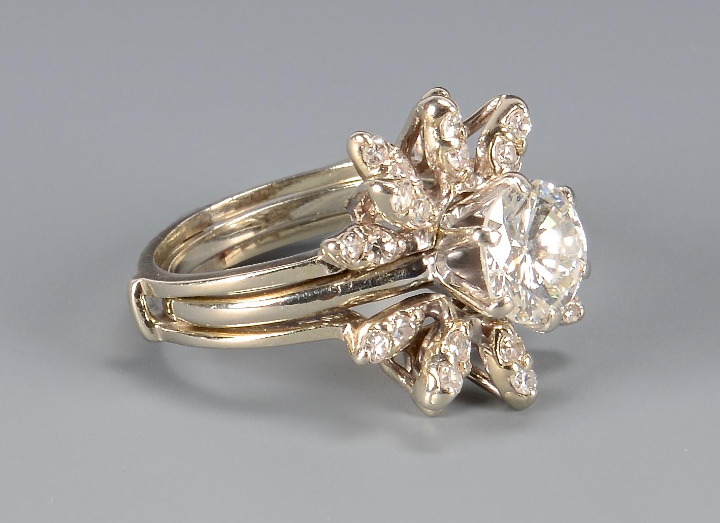 Lot 102: 2.02 Carat Diamond ring with guard