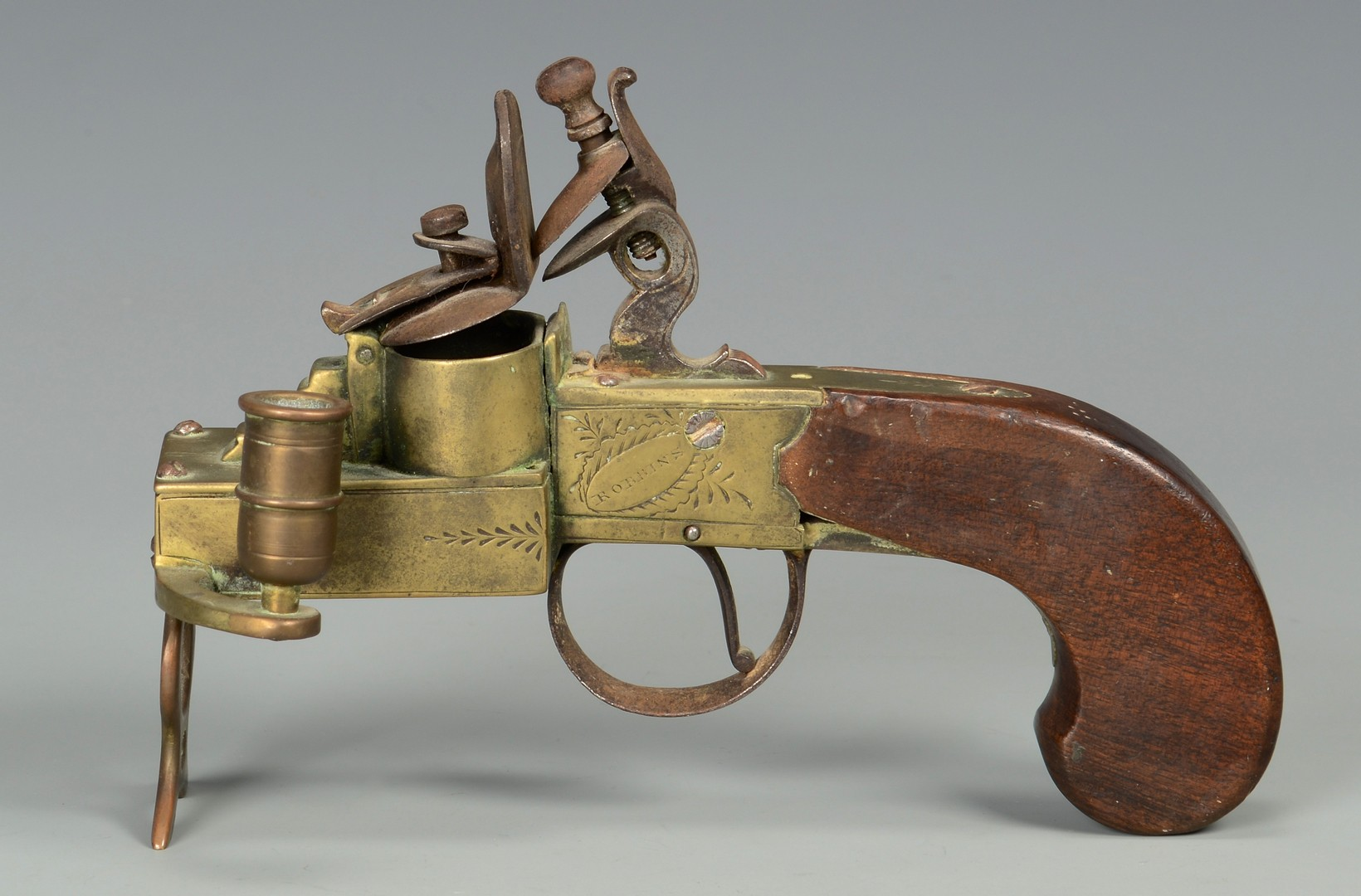 Lot 190: Flintlock Pistol Tinder Lighter and Large Flintlock Mechanism, 2 items