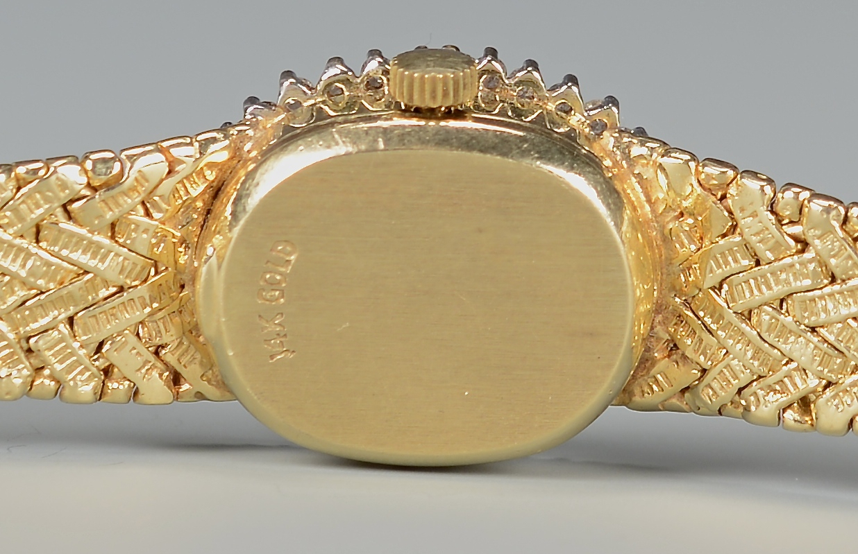Lot 387: 14k yg Lady's Diamond Wristwatch