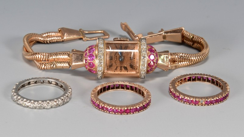 Lot 388: 14k Paul Ditisheim watch & 3 eternity bands