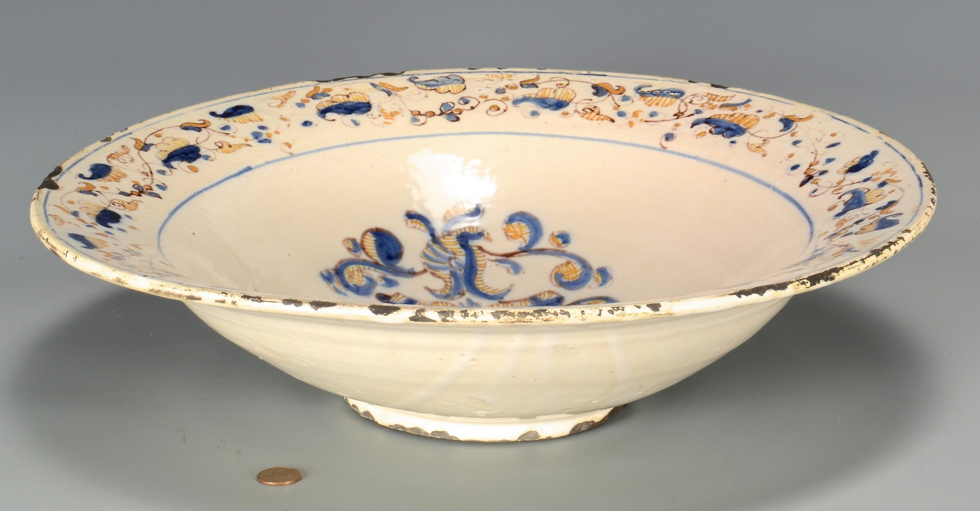 Lot 473: Continental Armorial Faience Bowl
