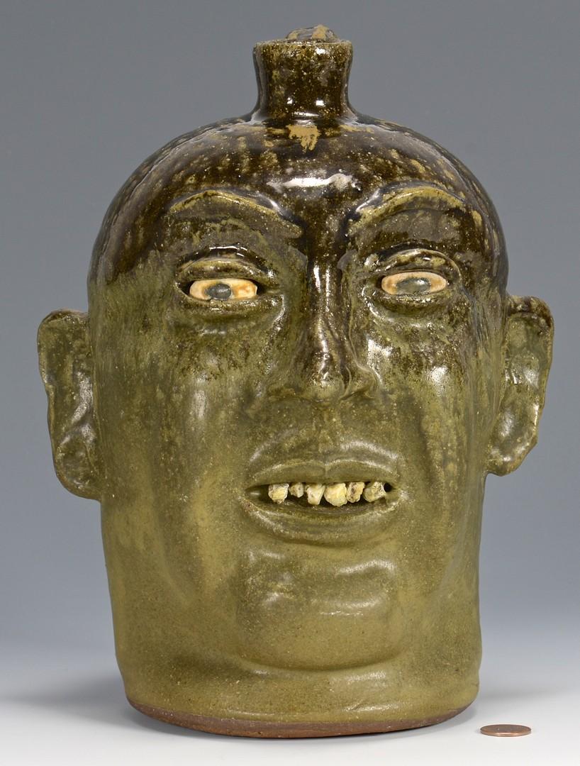 Lot 487: Lanier Meaders Face Jug, rock teeth