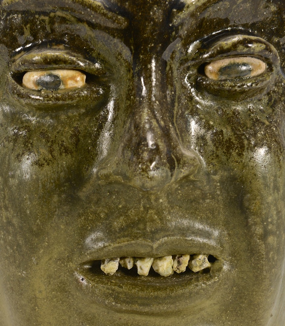 Lot 487: Lanier Meaders Face Jug, rock teeth