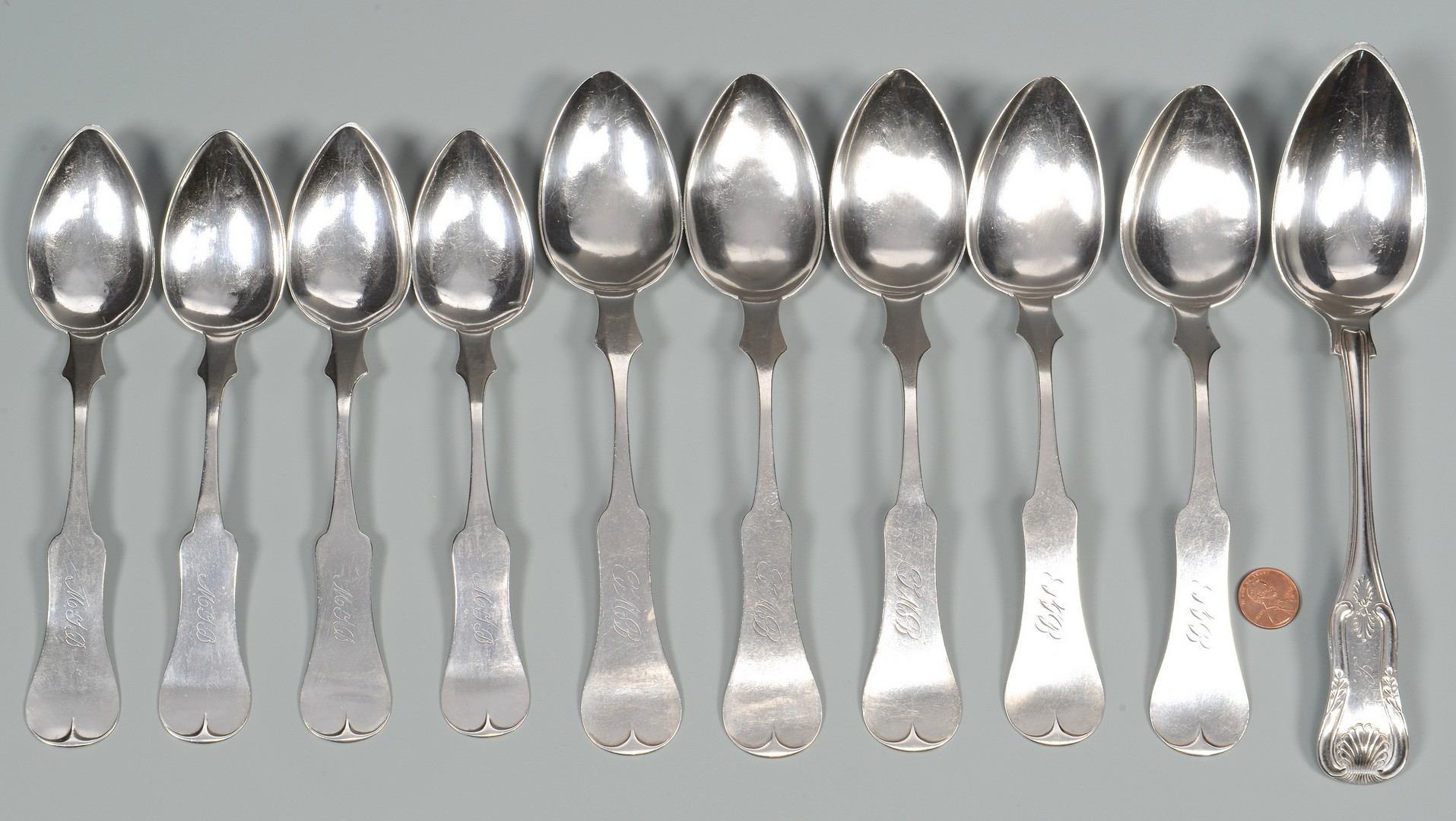 Lot 51: 10 Lexington, KY coin silver spoons