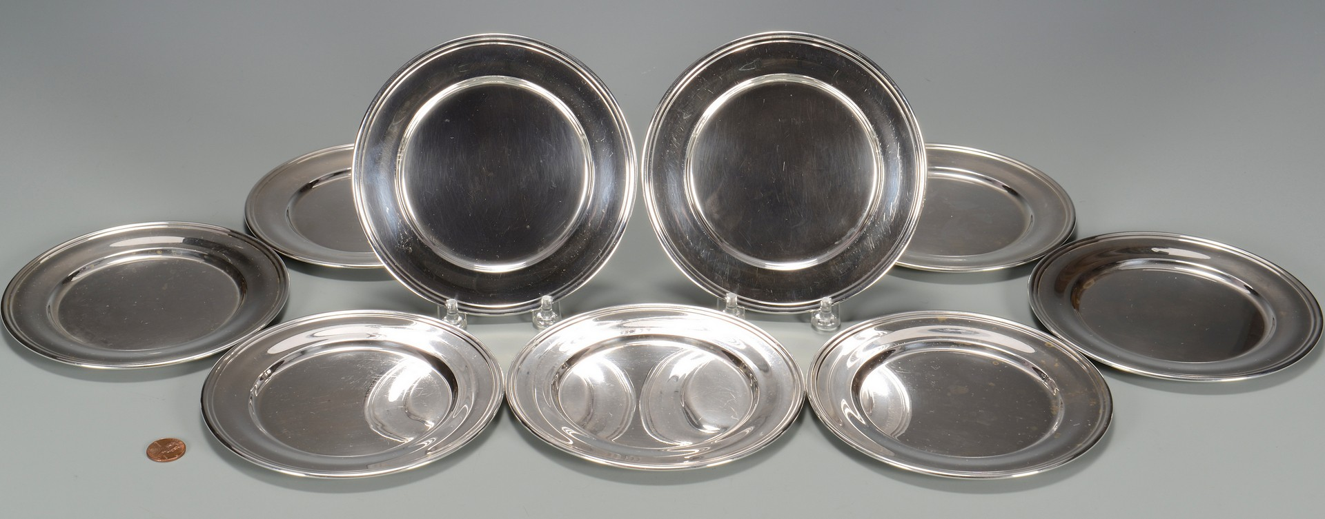 Lot 672: 9 Kirk Sterling Bread Plates