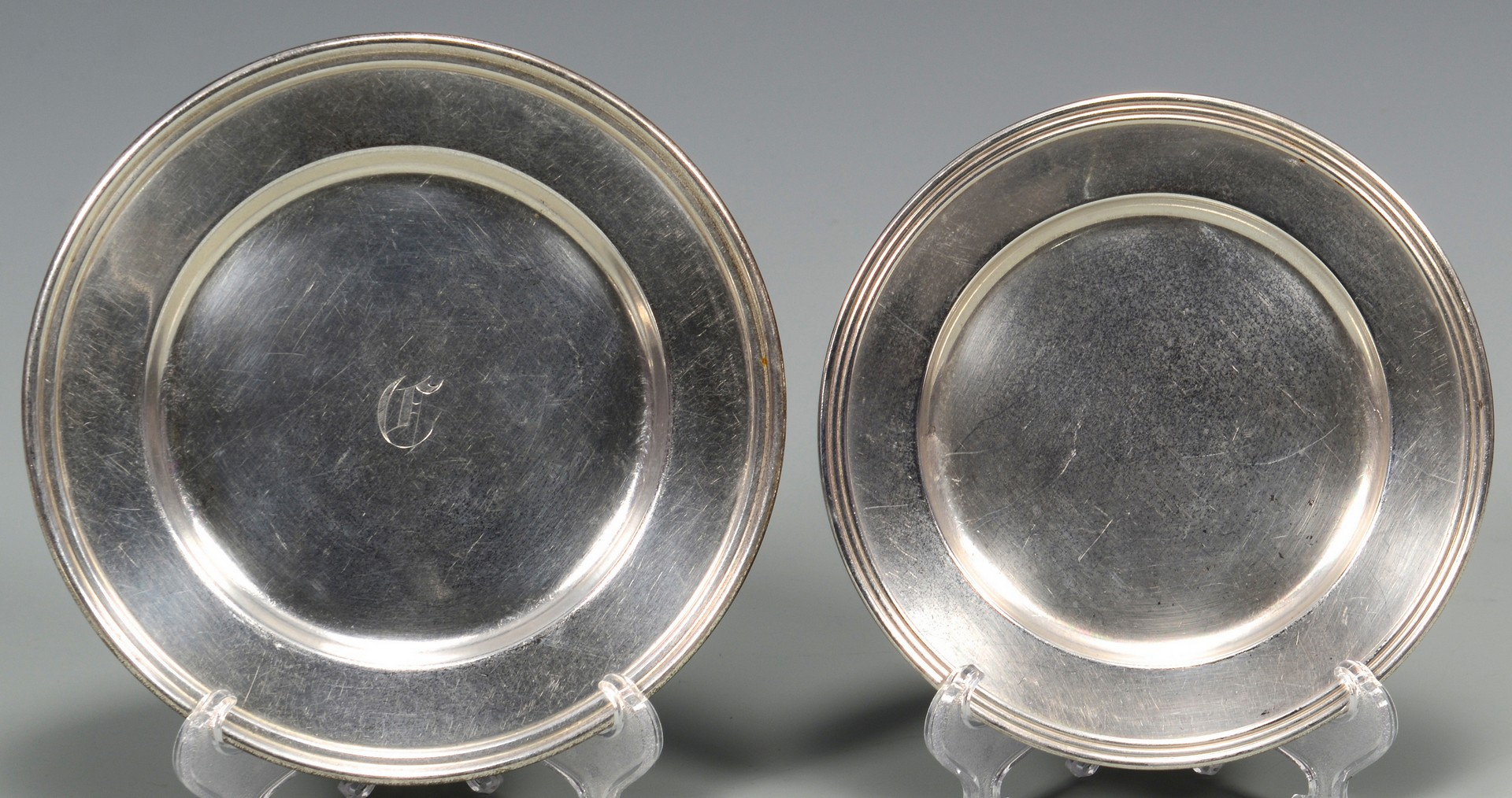 Lot 675: 14 Sterling Bread & Butter Plates