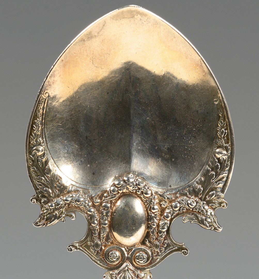 Lot 677: Silver Napoleon spoon, caster and candy dish