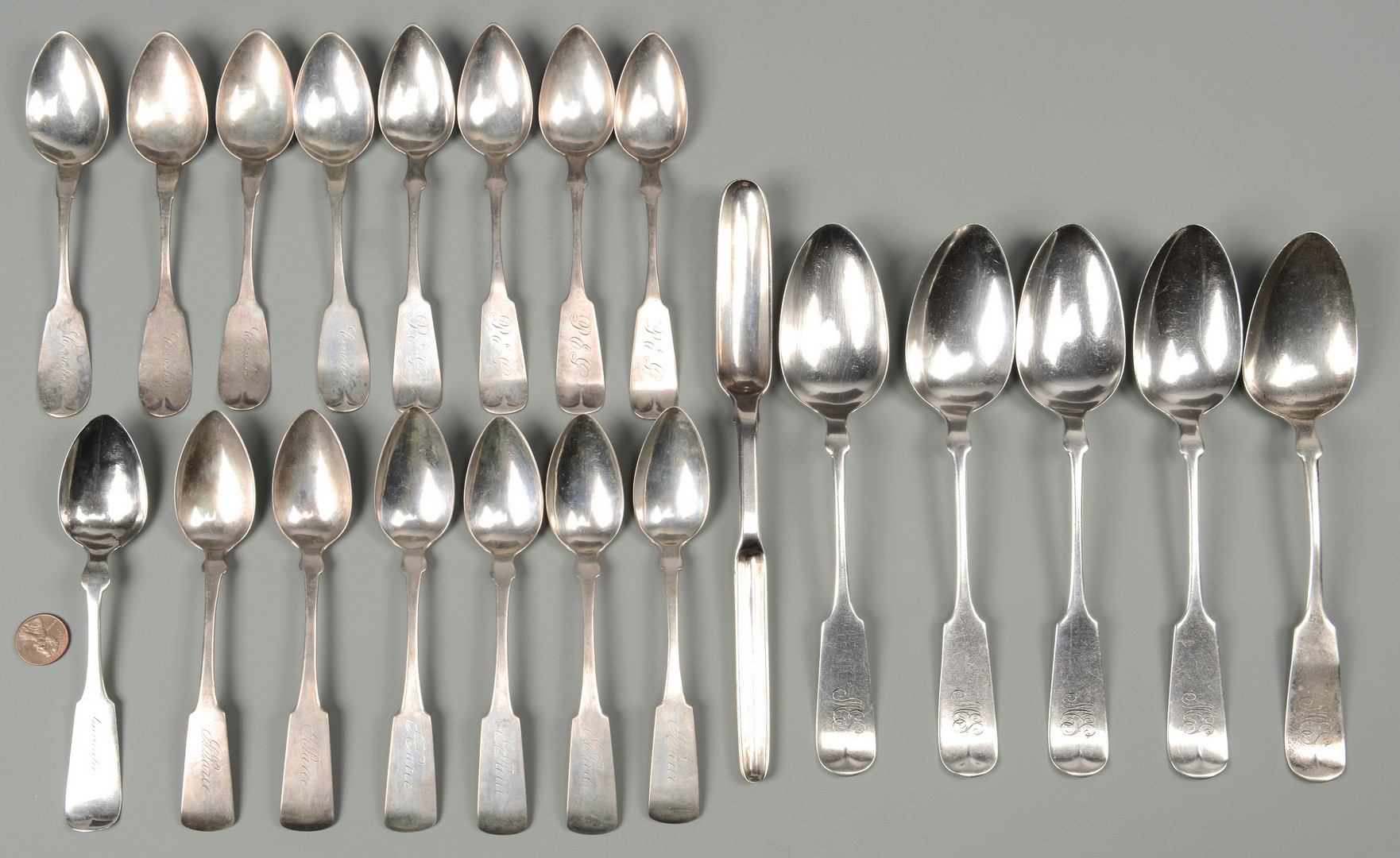 Lot 682: 21 Silver Table and Serving Spoons.