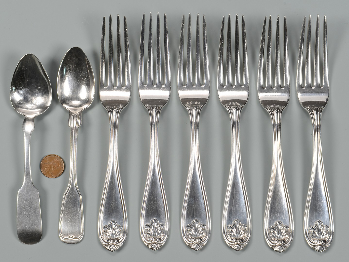 Lot 76: 8 pcs. Natchez Coin Silver Flatware