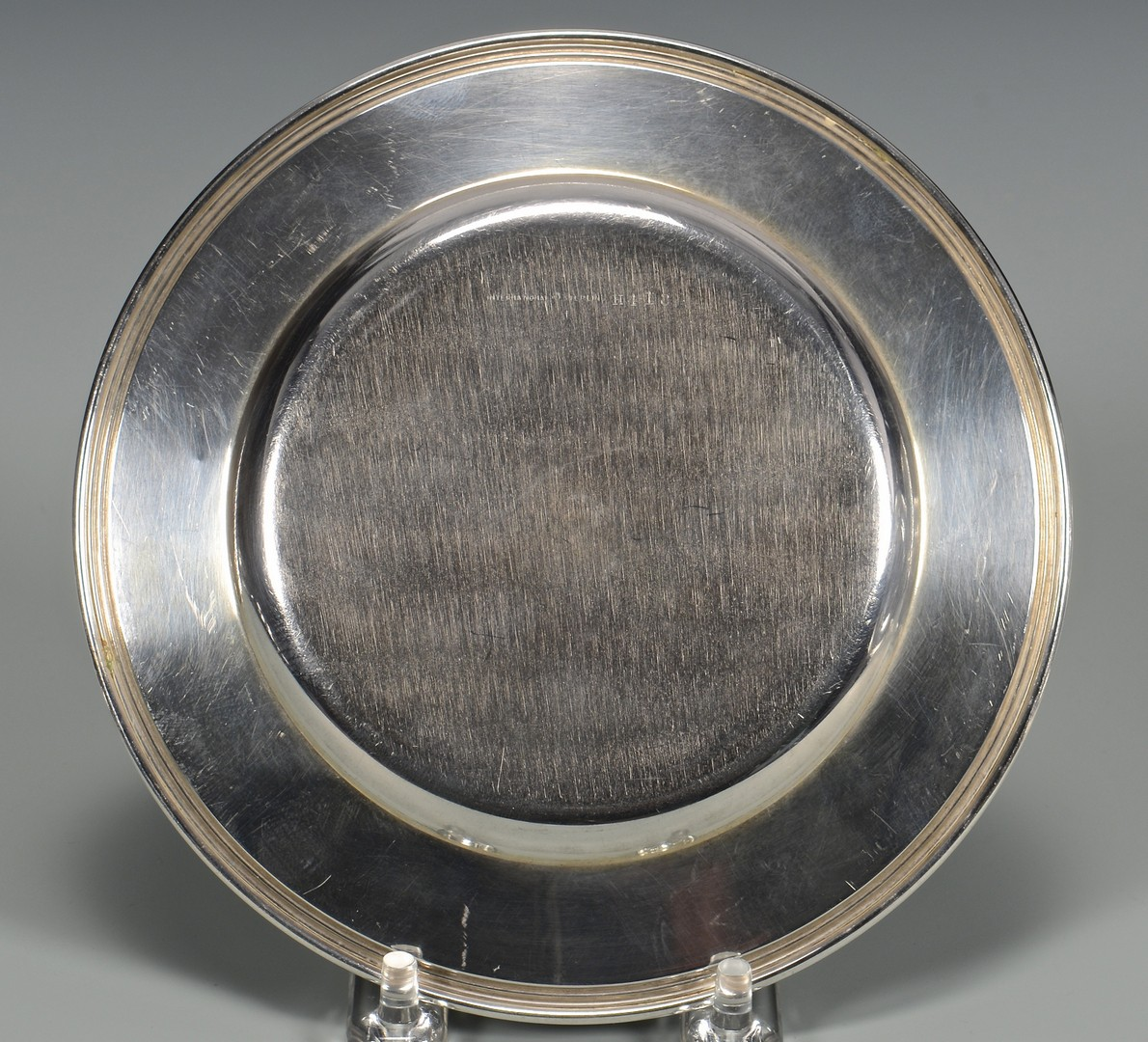 Lot 816: 7 Sterling Bread and Butter Plates