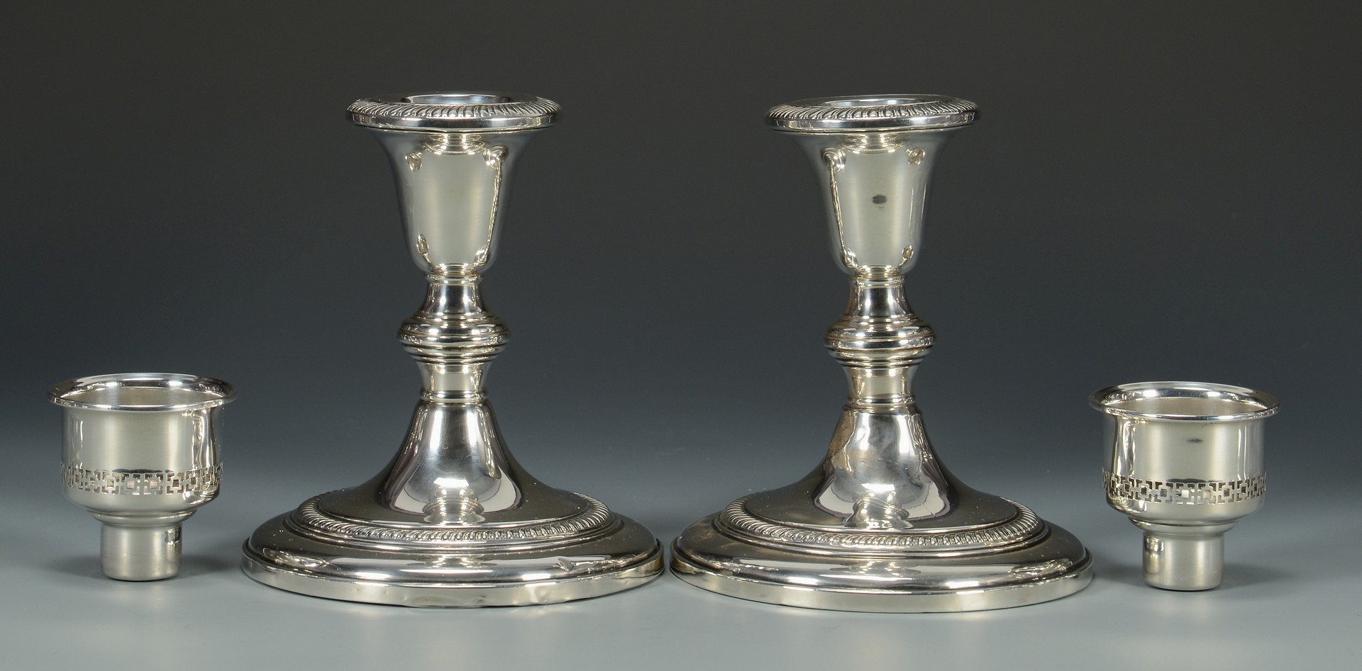 Lot 823: 6 Pair Sterling Wtd. Candlesticks