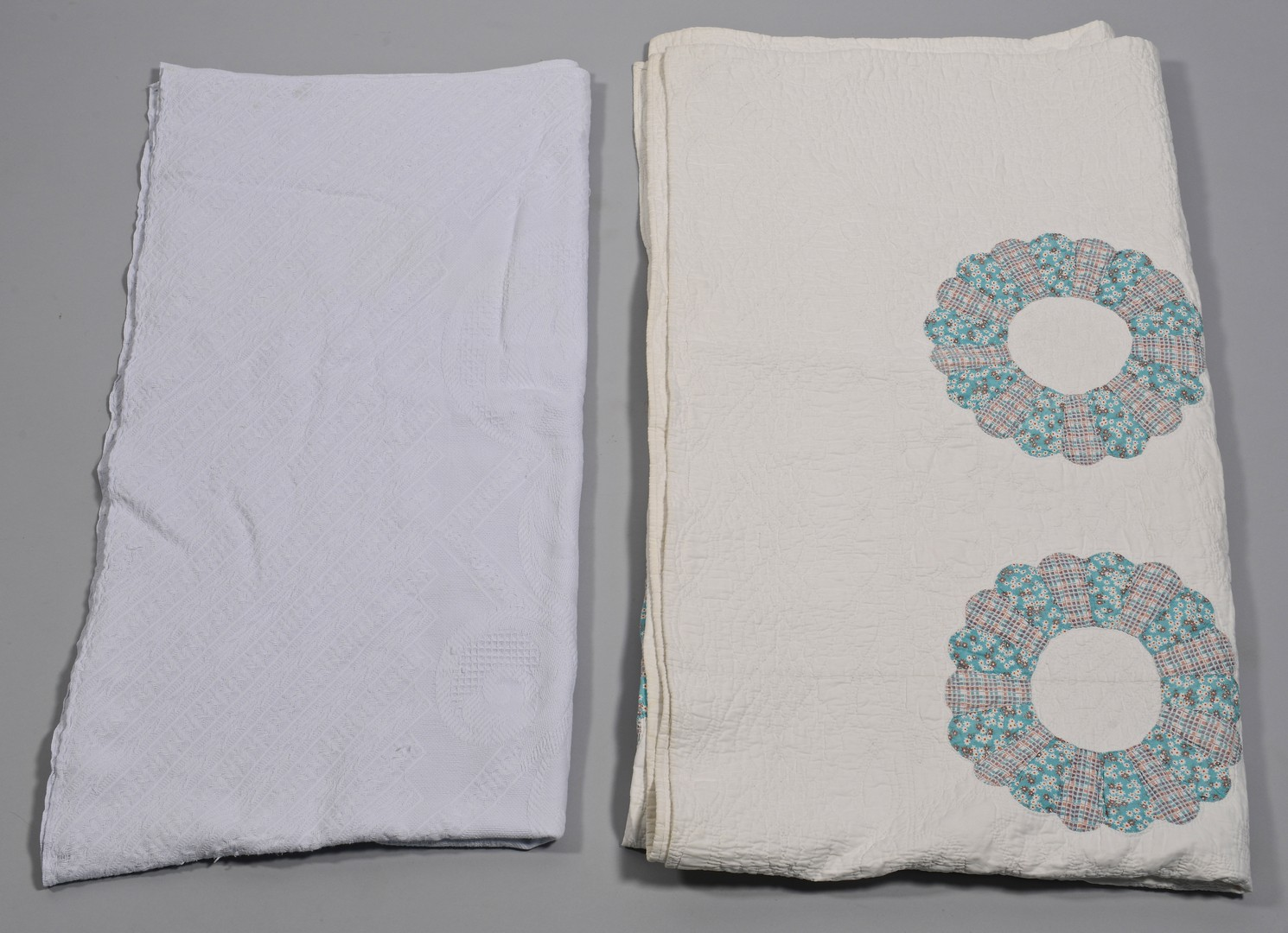 Lot 850: 3 quilts and 1 coverlet, mostly whitework