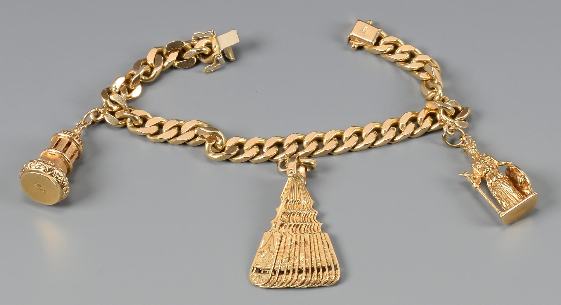 Lot 97: 18k bracelet, 3 charms, 61.8 grams