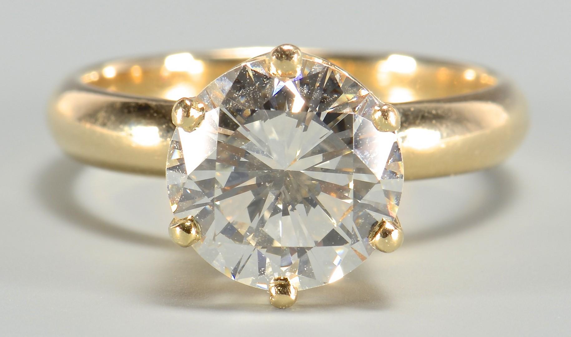 Lot 99: 3.10 round diamond, GIA cert., 14k