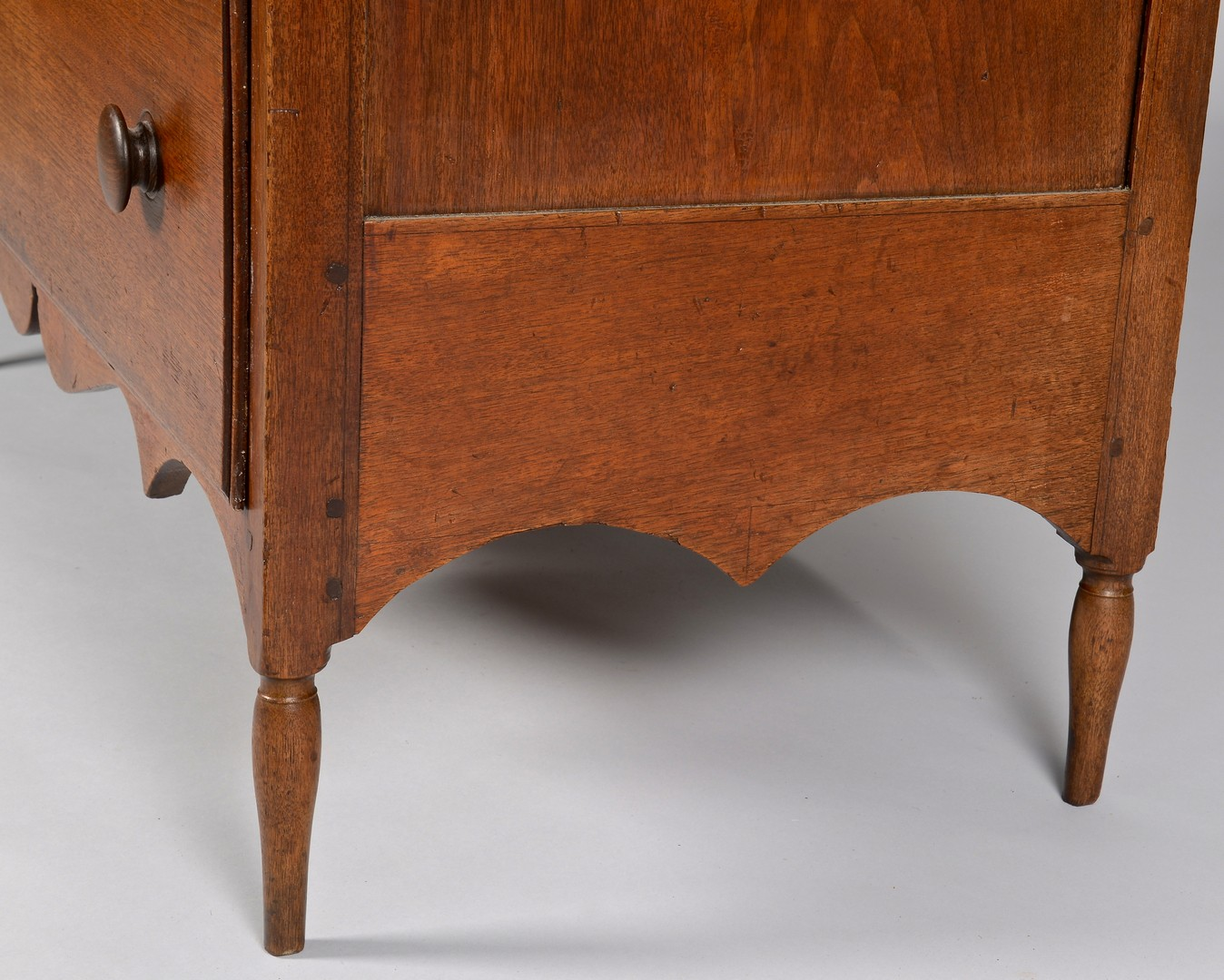 Lot 111: East TN walnut chest of drawers, elaborate apron