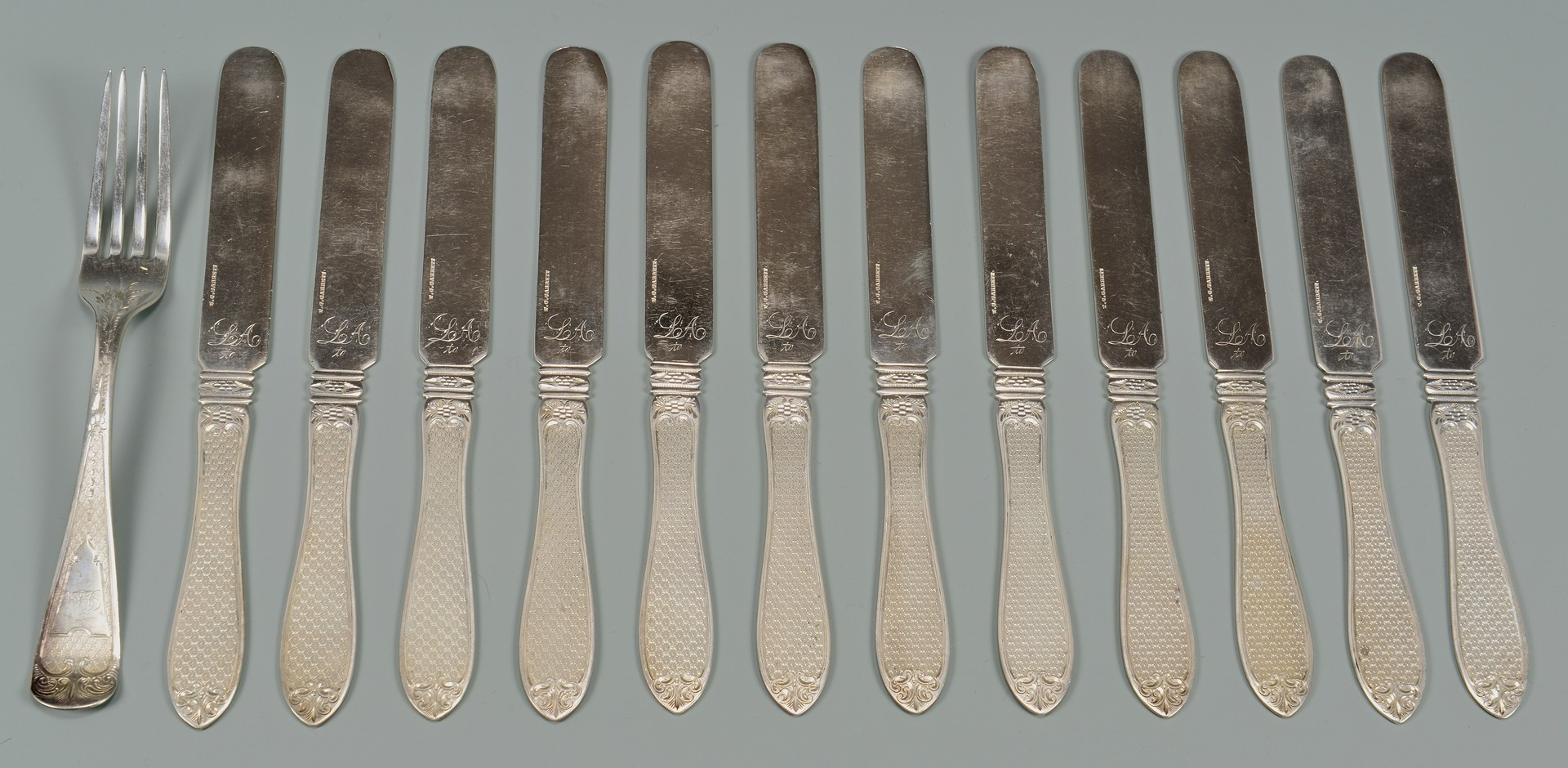Lot 322: 12 coin silver knives plus 1 fork