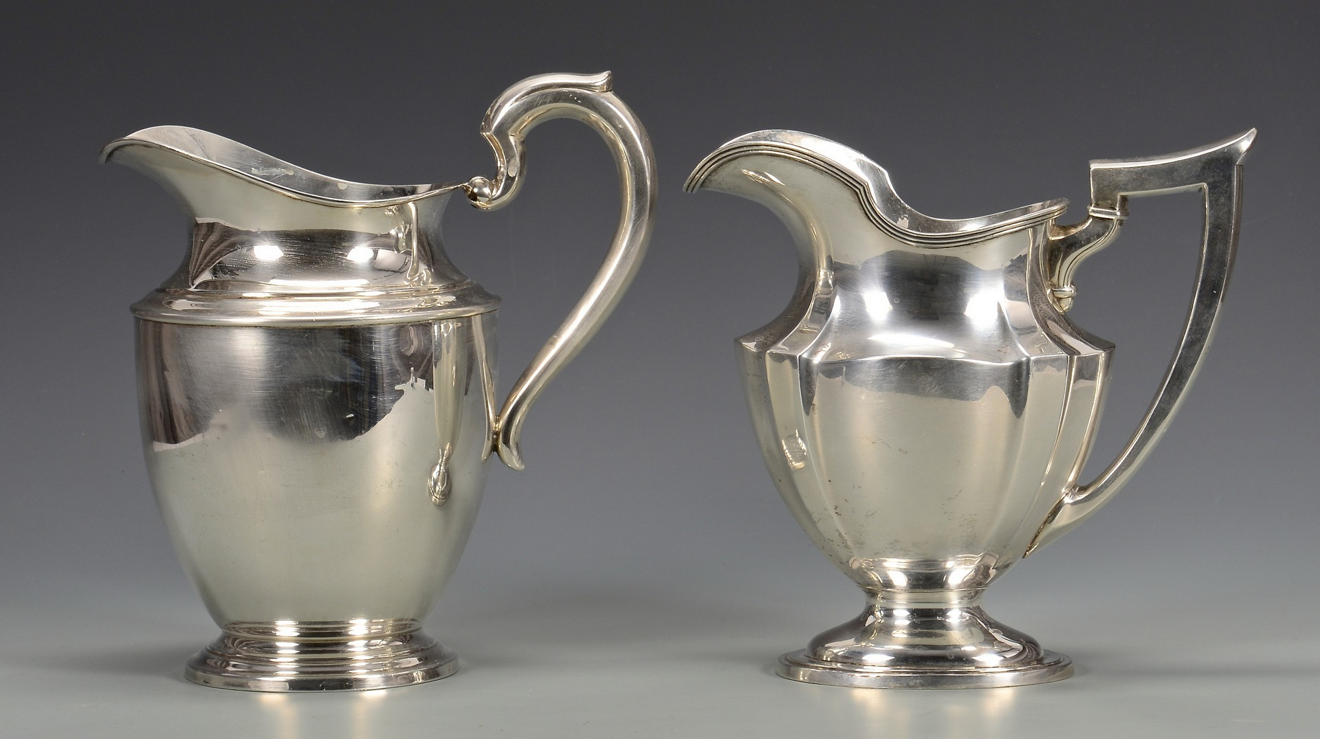Lot 339: 2 Sterling Silver Water Pitchers