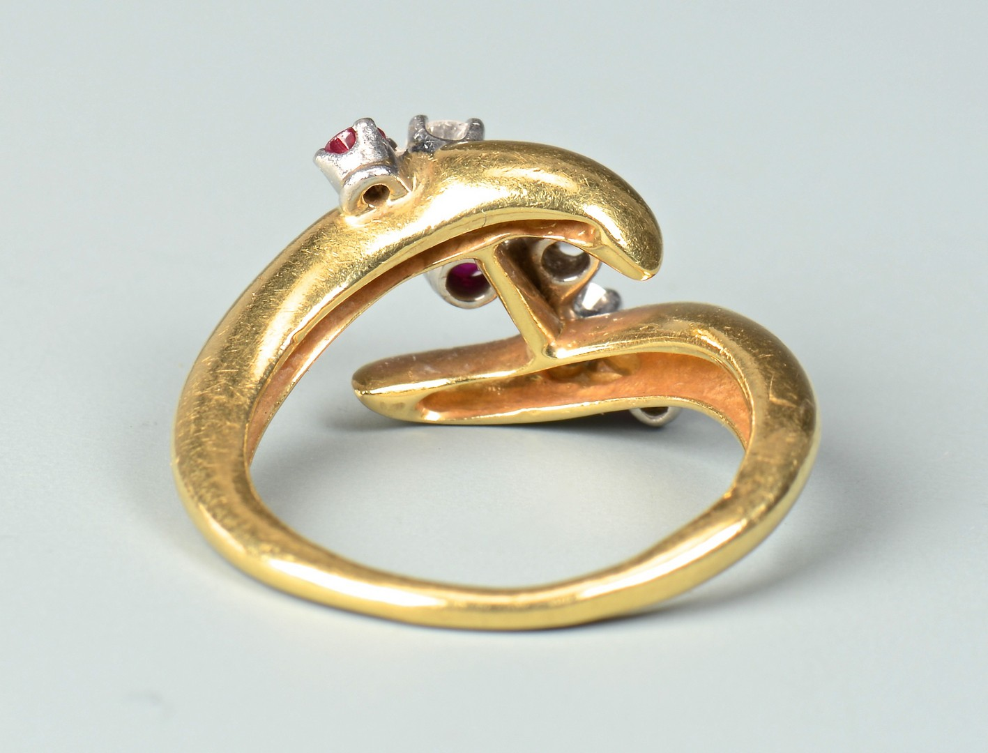 Lot 347: 18K yellow gold/plat ruby and diamond ring