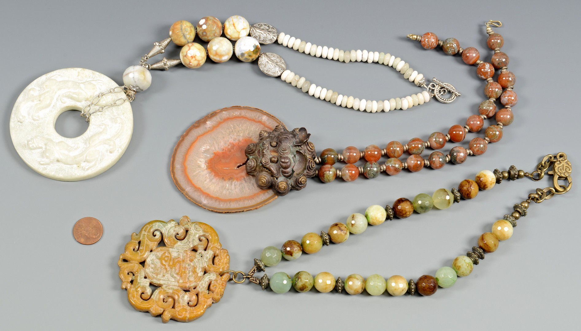 Lot 407: Asian jewelry, 3 necklaces, Earrings, and Bracelet