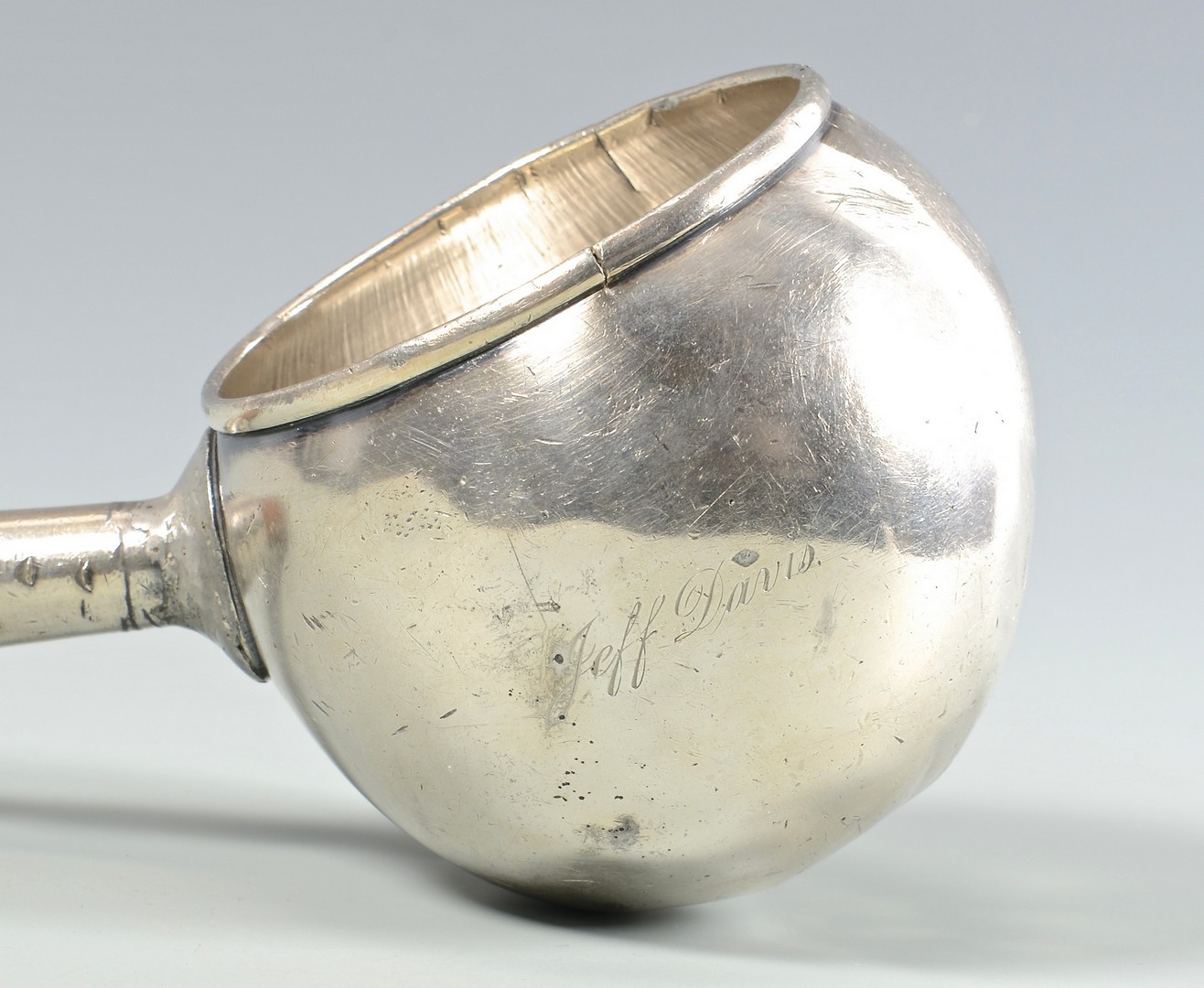 Lot 53: Coin Silver Dipper, Jeff Davis inscription