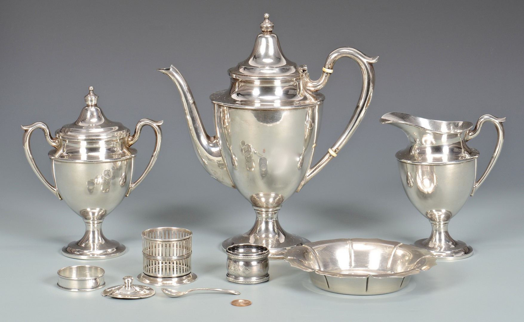 Lot 576: 3 Sterling Silver Tea Items & More