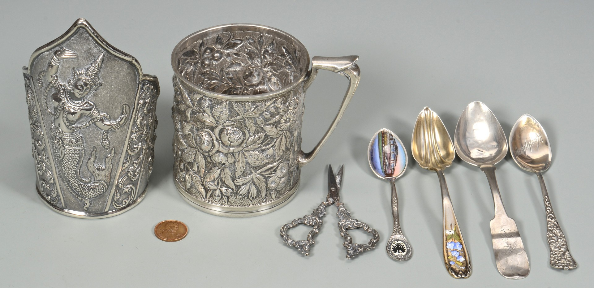 Lot 580: Sterling Repousse Cup, Asian Cuff, Spoons