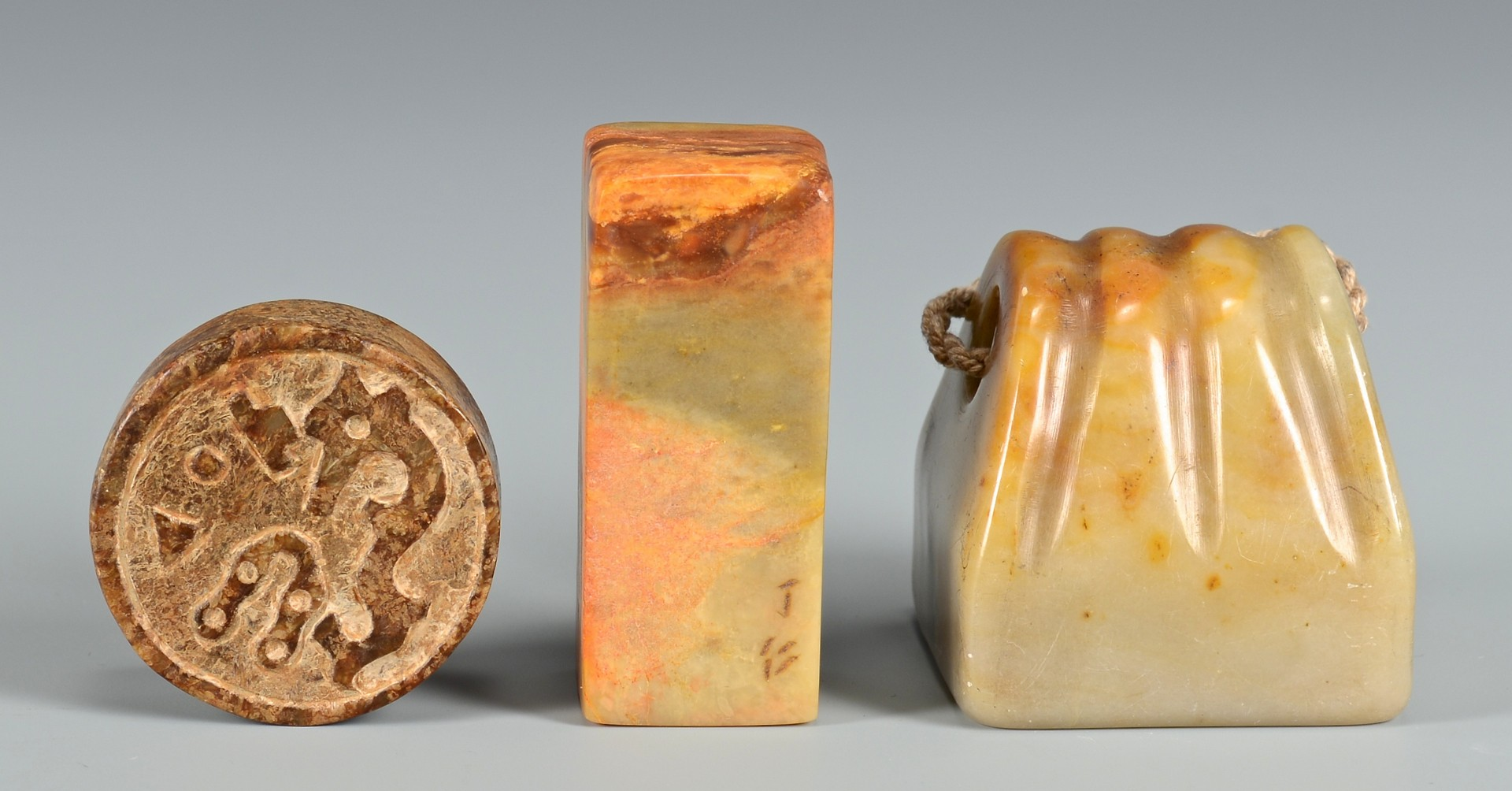 Lot 704: Chinese Hardstone Chops & Bangles
