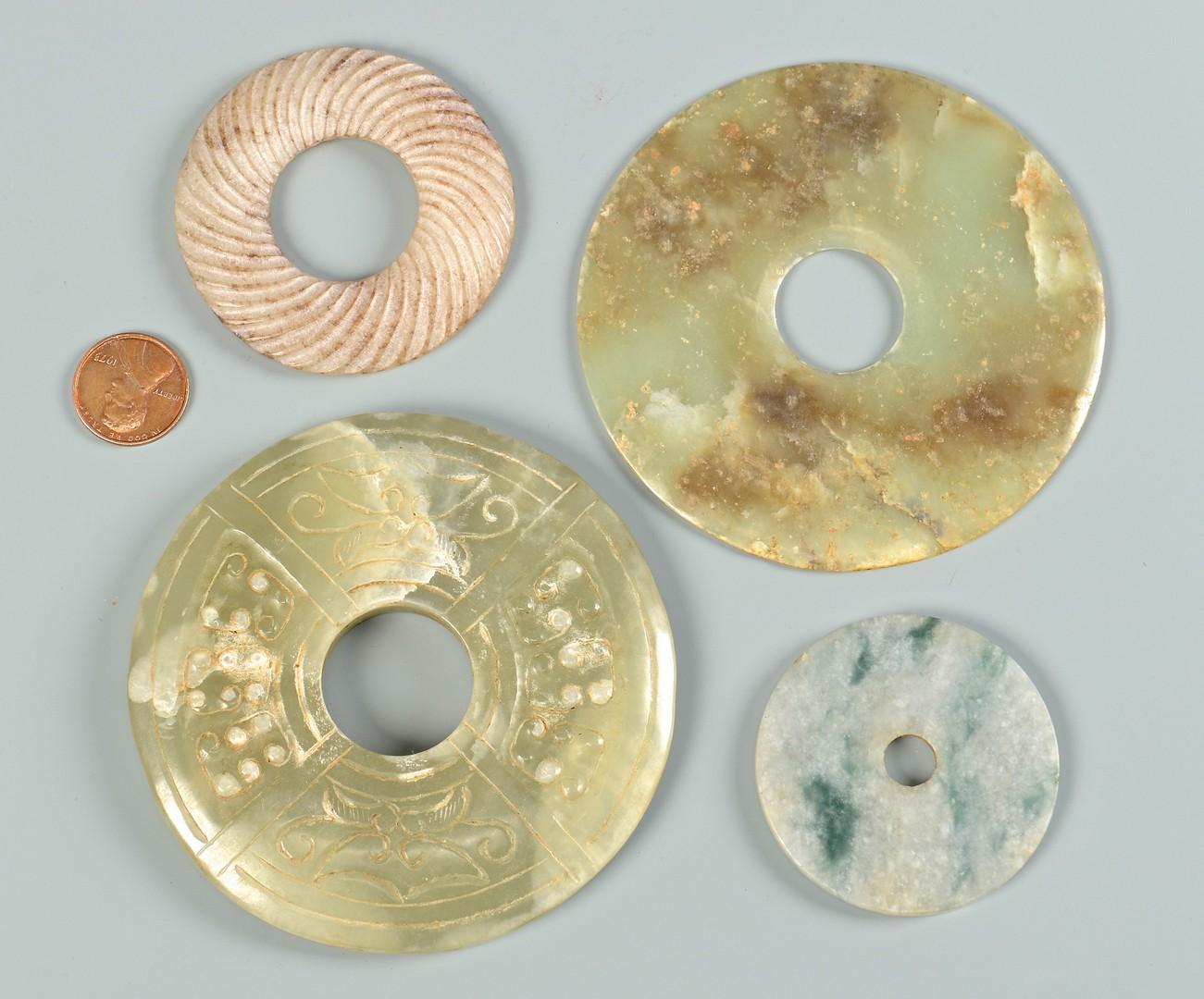 Lot 705: Jade bi discs and axe head, 5 items
