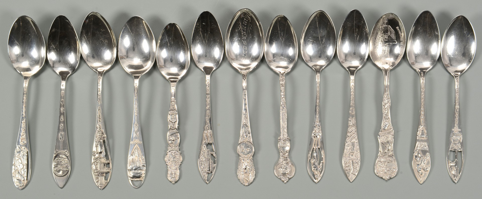 Lot 809: Lunt Sweetheart Rose flatware plus souvenir spoons