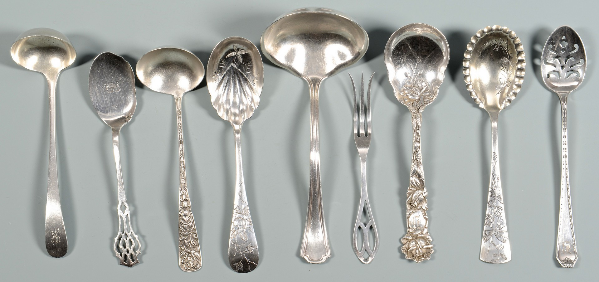 Lot 820: 29 pieces coin and sterling flatware