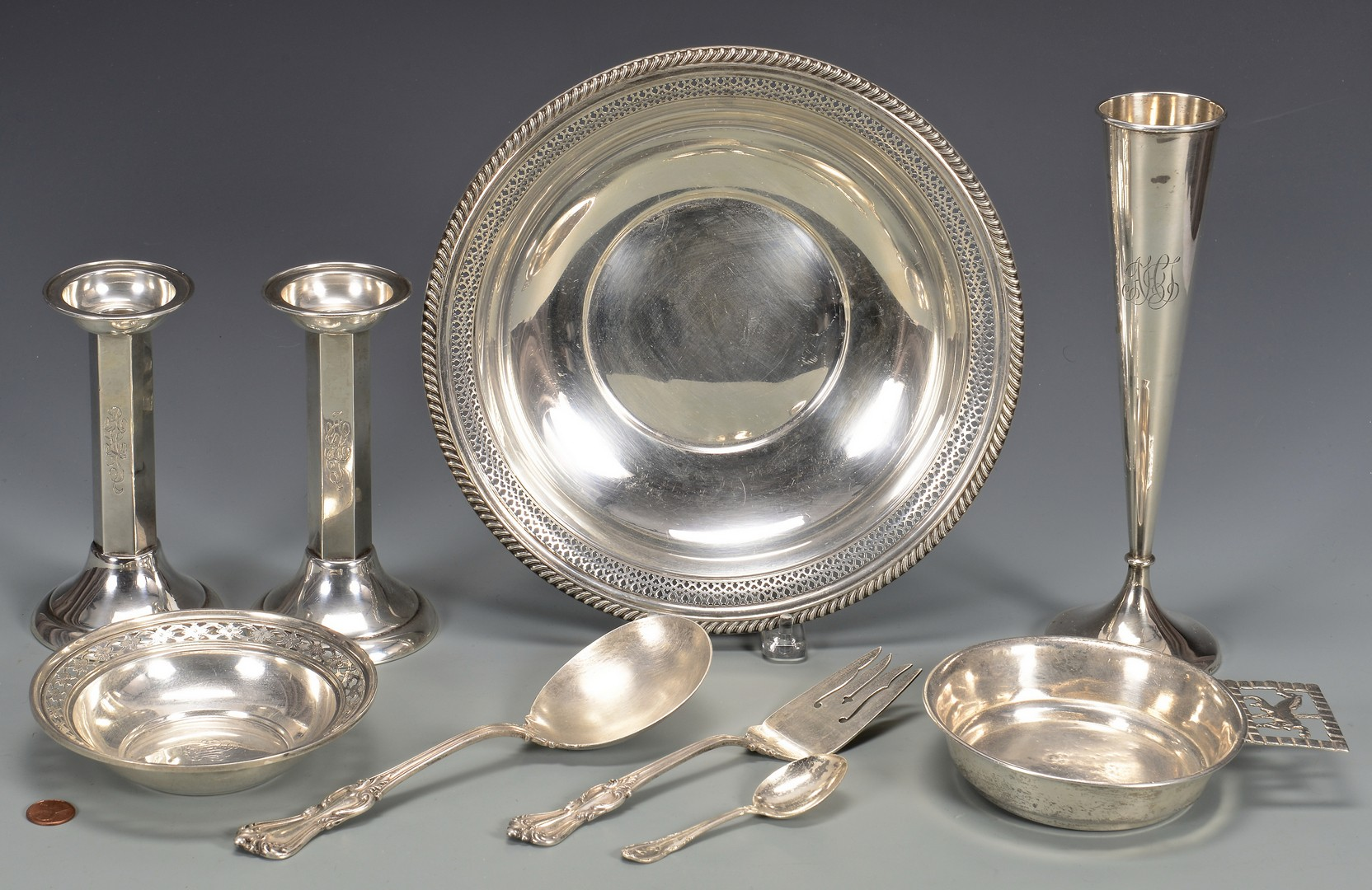 Lot 826: 9 Sterling Silver Table Items incl. candlesticks