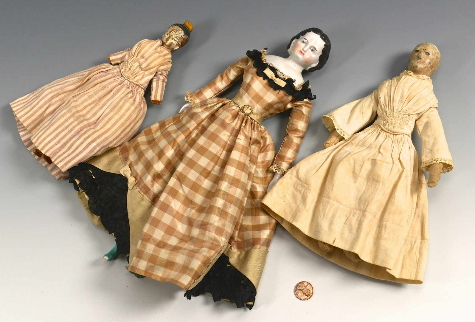 Lot 851: 19th Century Dolls: 1 porcelain, 2 wood