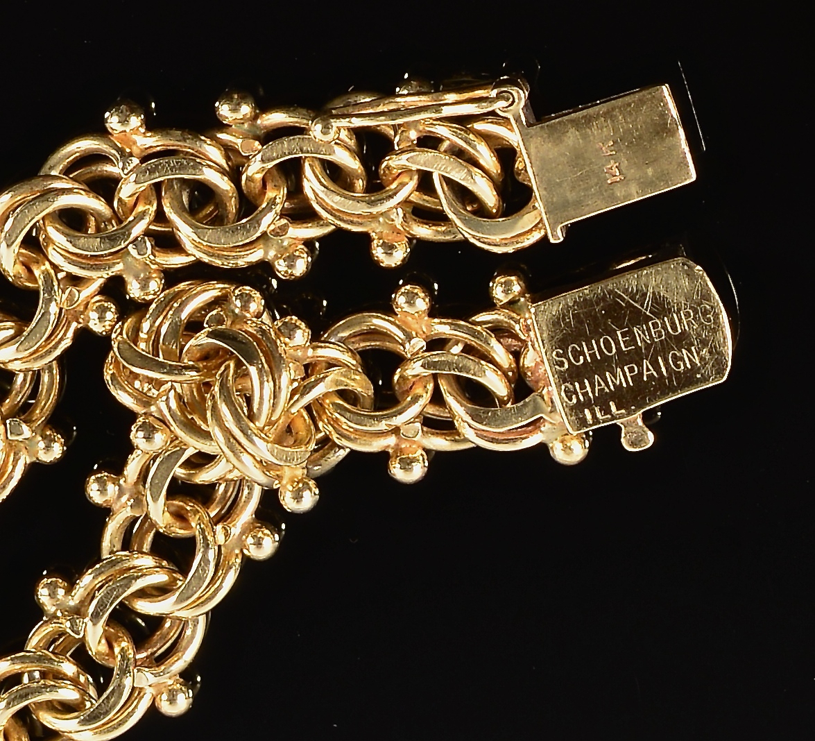 Lot 85: 14K Link Bracelet plus 14K-18K Charms