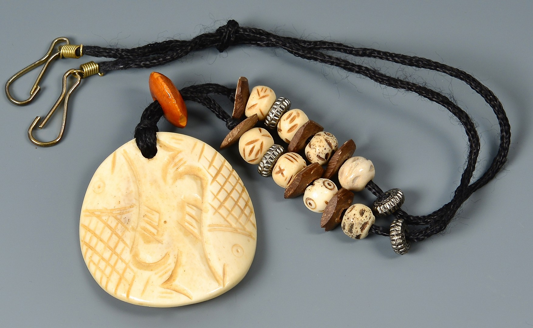 Lot 887: Group of 3 Carved Ethnic Necklaces